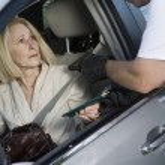 Man Assaults Woman With Firearm Through Car Window — Stock Photo #21871215