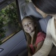 Daughter sitting in car with her mother — Stock Photo #21871487