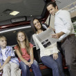 Low angle view of family sitting at back of car — Stock Photo