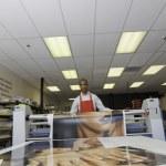 Worker taking printouts at printing press — Stock Photo