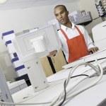 Man operating printing machine at press — Stock Photo