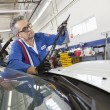 Senior mechanic working on windshield wipers — Foto Stock