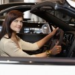Woman having a test drive — Stockfoto