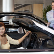 Womhaving test drive while salesperson standing besides car — Stock Photo #21872931