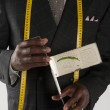 Midsection of tailor holding a measuring device — Stock Photo #21873089