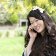 Close up portrait of young woman talking on mobile phone — Stock Photo