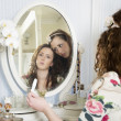 Sisters at dressing table — Stock Photo #21873761