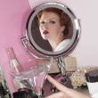Reflection of beautiful woman in the mirror with martini glass on table — Stock Photo #21874237