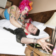 Pink haired woman threatening man - Stock fotografie