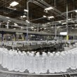 Bottled water on conveyor at bottling plant — ストック写真 #21874665