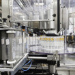 Bottling machine at bottling plant — Stock Photo #21874681