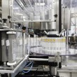 Bottling machine at bottling plant — Stock Photo