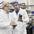 Two men working in bottling factory — Stock Photo