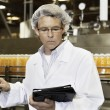 Middle-aged man working in a bottling factory — Stock Photo