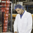 Man working at factory — Stock Photo