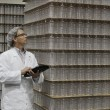 Man inspecting bottled water in distribution warehouse — Stock Photo