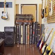 Electric guitars with guitar cases and amplifier in store — Stock Photo #21876131