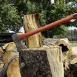 Stock Photo: Axe in log stump