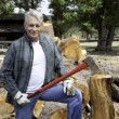 Portrait of senior lumber jack holding an axe — Stock Photo