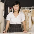 Portrait of female dressmaker at clothing store — Stock Photo