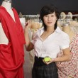 Young woman standing near the mannequin - Stock Photo