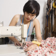 Fashion designer sewing fabric — Stok fotoğraf