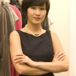 Portrait of confident Asian fashion designer standing with arms crossed — Stock Photo #21876797