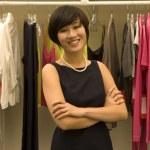 Portrait of happy Female fashion designer standing arms crossed — Stock Photo