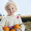 Portrait of a girl holding pumpkins — Stock Photo