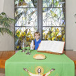Stock Photo: Little boy standing by altar table