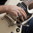 Close-up of man's hand playing electric guitar — Stock Photo