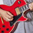 Royalty-Free Stock Photo: Midsection of man playing electric guitar