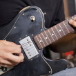 Close-up view of man playing electric guitar — Stock Photo #21877149