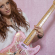 Pretty teenage girl playing guitar — Stock Photo