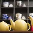 Low angle view of yellow tea kettles — Stock Photo
