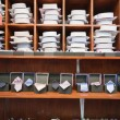 Stock Photo: Shirts, neckties and hand cuff links displayed on shelves