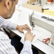 Close-up of man sewing with machine — Stock Photo