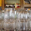 Upturned glasses at a pub counter - Stock Photo