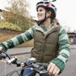 Young woman riding bicycle on street — Stock Photo
