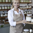 Portrait of a happy senior female employee in spice store — Stock Photo