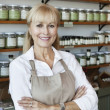 Portrait of a happy senior employee with arms crossed in spice store — Stock Photo #21878345