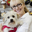 Portrait of senior pet owner shop with dog — Stock Photo