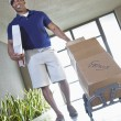 Happy African American delivery man — Stock Photo