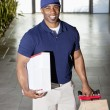 Portrait of a happy delivery man with packages — Stock Photo