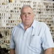 Portrait of a senior male owner of key store — Stock Photo