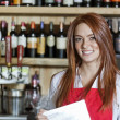 Portrait of a beautiful young waitress — Stock Photo