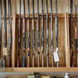 Rifles on display in gun shop - Stock Photo