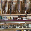 Weapons displayed in gun shop — Stock Photo #21879677
