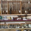 Weapons displayed in gun shop - Stock Photo