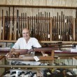 Portrait of a happy weapon shop owner — Stock Photo